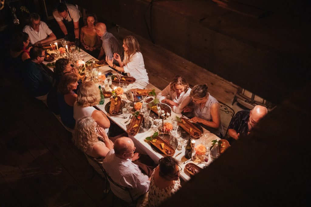 A group of people sit around a dinner table