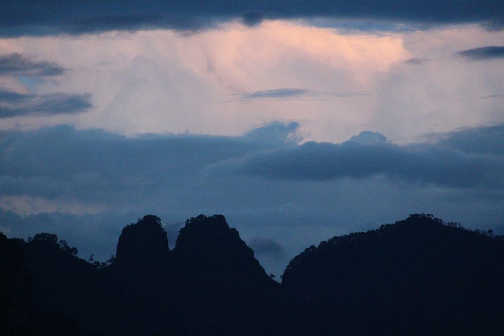 Mountain range with dark clouds overhead