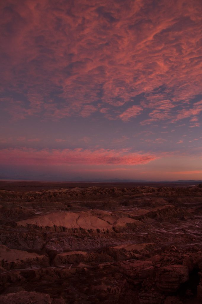 A tall mountain with pink sunset in the atacama desert